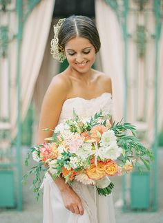 Luscious and full peach bridal bouquet. I love the peach with the white flowers and greenery too!