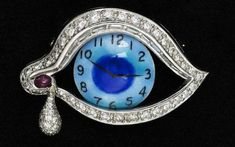 "Eye of Time brooch. ""Man cannot escape or change his time. The eye sees the present and the future."" -Dali"