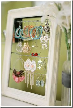 Supplies: picture frame, 12′ of picture wire, acrylic paint & brush, staple gun (or nails/tacks, etc)  for instruction go to:  http://www.kevinandamanda.com/whatsnew/house-and-home/tutorial-shabby-chic-dangly-earring-display.html