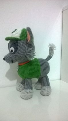 Character of the canine patrol made in crochet aprix Paw Patrol Hat, Paw Patrol Rocky, Crochet Amigurumi Free Patterns, Crochet Dolls, Free Crochet, Rocky Pat Patrouille, Homemade Crafts, Crochet Animals, Crochet Projects