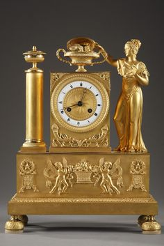 e5f2ff60e0e An early 19th century gilt bronze mantel clock signed POIRET à Beaumont  Justa