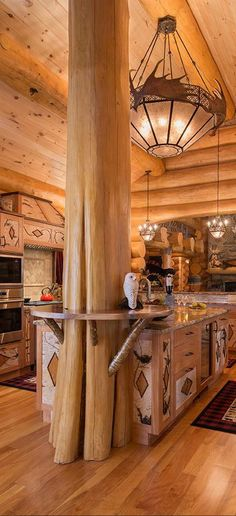 Sitka large rustic Log Homes - love this western themed kitchen