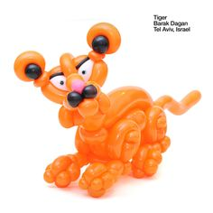 This orange crouching balloon tiger is a real piece of art.