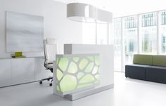 Simple, understated elegance: this organic-style reception desk takes your lobby area design to a whole new level and caliber of high-end modern design. Collaborate with us on your next office project or design upgrade.