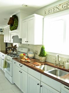 This country kitchen got a fabulous upgrade when the basic countertops were replaced with gorgeous, custom butcher-block countertops.