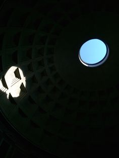 Sun shines through the oculus onto the inside of the pantheon's dome.