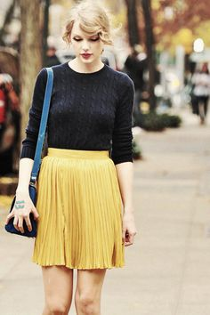 Taylor Swit | Navy jumper & pleated yellow skirt. I like the elements of this outfit and Taylor's general cuteness.
