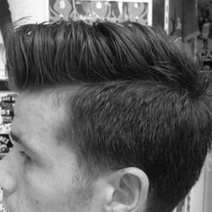 Liam wants this: High shaved semi blended sides with a messy rollover on top.
