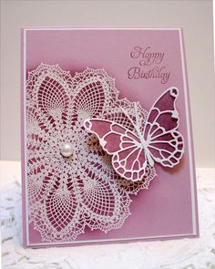 Stampin Up doily stamp embossed with white and possibly sponged with rich razzleberry---must buy soon!