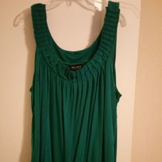 Cute green/teal top This is a really comfy top. It's banded at the bottom and has pleats at the top on the collar. It is sleeveless. It's in between a teal and green color, the pictures don't do it justice. It's a beautiful colored top Tops Blouses