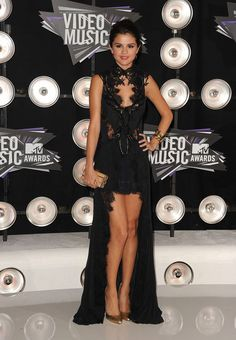 Selena Gomez Fishtail Dress - Selena Gomez donned a Gothic-inspired gown at the VMAs. The black and lacy frock featured sheer panels, a high collar and an asymmetrical hem that showed off her toned legs.