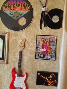 Actual musical instruments, classic albums, framed magazine covers, and artwork decorated this photo backdrop and made it all about the couple's favorite bands.