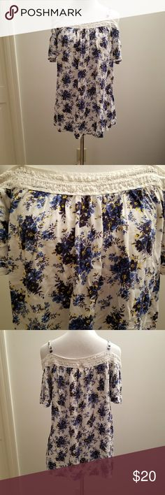 Torrid Size 2 Off Shoulder floral Top white blue Condition: Excellent Used Condition Brand: Torrid Color: White and Blue Size: 2  Super cute blue floral print top. Off the shoulder with tank top straps. Pairs great with a pair of jeans or a cute skirt.   Smoke Free Home. torrid Tops Blouses