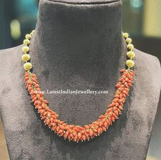 Coral beads gajra necklace in gold from Parnica jewels with gold balls back chain is a lovely piece of jewellery to own with bunches of light orange corals Gold Chain Design, Gold Jewellery Design, Bead Jewellery, Gems Jewelry, Pearl Necklace Designs, Gold Earrings Designs, Beaded Necklace, Coral Jewelry, Bridal Jewelry