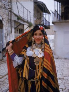 Africa | Tunisian Jewish Woman Wearing Elaborate Wedding Dress During the Celebration of Purim| ©Alfred Eisenstaedt