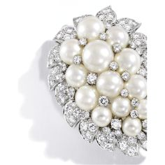 Platinum, Cultured Pearl and Diamond Brooch, Van Cleef & Arpels, New York The paisley-shaped cluster centering 13 round cultured pearls, accented by round diamonds weighing approximately 5.65 carats, signed Van Cleef & Arpels N.Y., partially numbered 349_1.
