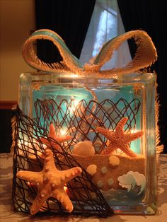 Beach theme glass block with sand, lights, net, and burlap using white christmas lights, how cool is that! Seashell Projects, Seashell Crafts, Beach Crafts, Diy Crafts, Wood Crafts, Coastal Christmas, Christmas Diy, Christmas Decorations, Beach Christmas