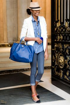 chambray shirt, skinny jeans, white blazer, fedora, and pops of color