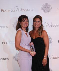 receiving our Platinum Wedding award for best invitation designer, Platinum Weddings Magazine.