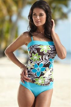 Cute, modest swimsuit- Love the top!!! Would wear my shorts still though
