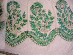 beetle wing embroidery.
