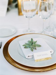 Succulent accented place setting: http://www.stylemepretty.com/destination-weddings/spain-weddings/2016/05/05/beautiful-wedding-in-the-sunny-marbella/ | Photography: Joseba Sandoval - http://www.romanceweddings.co.uk/