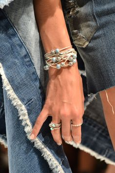 Different shades of blue at PANDORA and Siwy Denim's fashion show at Coachella! Lots of PANDORA ESSENCE COLLECTION bracelets with turquoise Wisdom charms and PANDORA rings with blue gems combined with denim. #PANDORAstyle