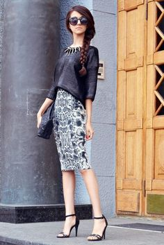 pretaportre:    Street Style: Tina Sizonova wearing a Mango skirt, Mango sweater, Zara heels, TopShop necklace, and Asos sunglasses.