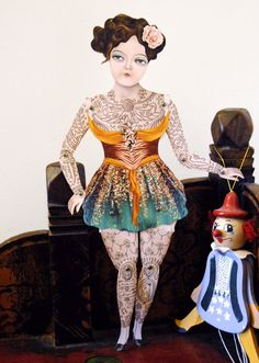 Victorian Tattooed Gal Paper Puppet Doll. 20.00, via Etsy. This is an artist created and signed version similar to the free template download by CrankBunny - http://www.etsy.com/listing/75142208/victorian-tattooed-gal-paper-puppet-doll?    free doll template is at http://www.etsy.com/blog/en/files/2012/10/puppet-puppet.jpg