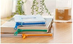 These zipper-shaped bookmarks to keep your place. | Can You Get Through This Post Without Spending $50?