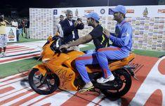 Virat Kohli (L) and MS Dhoni ride on a bike after winning their Twenty20 match against Sri Lanka in Pallekele.