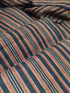 Barbara Pickel - handwoven linen fabric with hand dyed yarns in indigo, madder, hibiscus.