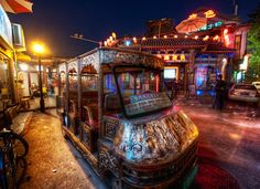 Ornate Taxi in Beijing. This little taxi reminded me a bit of those crazy Burning Man cars! It parked here for just long enough for me to grab a photo. After it left, I realized that I think wanted a ride in it… but I was too busy getting lost in taking the photo to keep my wits about me. - Trey Ratcliff