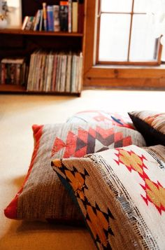 Ethnic pillows are so warm and inviting. My amazing architect father has Kilim pillows in his living room nook. The colors are so very masculine. ~ETS
