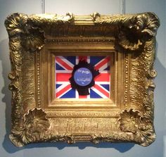 God Save The Queen - Union Jack  58 x 53 cm (Gold Rococo frame)  Unique Edition of 10  Mixed media - Vinyl  And it is all sooo establishment until you read the label!