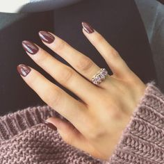 Cute brown manicure with chunky knit and ring