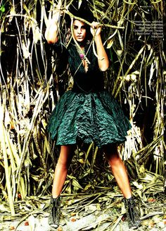 Emerald, as seen in Vogue (India) Jun 2010, Dress & Waistband by Krizia, Ankle Boots by Giuseppe Zanotti, 'Treasure Chest Collar' Necklace by Valliyan by Nitya Arora, Model - Jacqueline Fernandez, Photographer - Prasad Naik