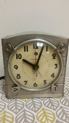 Art deco industrial Mantle clock general Electric https://www.etsy.com/listing/237925402/art-deco-industrial-mantle-general