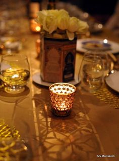 The Moroccan Star Border Stencil with gold spray paint was used by Maryam Montague of Marrakesh by Design to create gorgeous custom placemats for a glittery New Year's Eve Dinner | Royal Design Studio