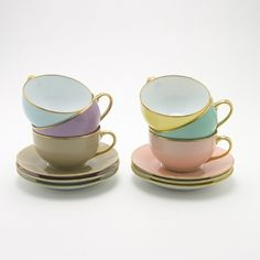 I have some pretty mismatched teacups and saucers, but this is such a lovely way of having the mismatched look in a uniform way
