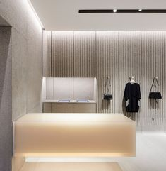 Floating storage under hanging clothes- can also double as shelving for accessories Lobby Interior, Retail Interior, Interior Architecture, Commercial Design, Commercial Interiors, Clothing Store Design, Fashion Store Design, Fashion Stores, Retail Store Design