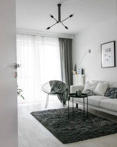Ein Trendiger Sessel Eine Gemtliche Couch Das Stylische Kissen Knot Sowie Der Flauschige Teppich Amore Sorgen Fr Graue Eleganz In Diesem Wohnzimmer