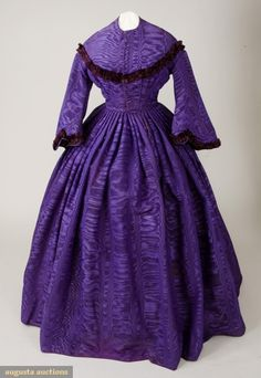 Purple Silk Dress, 1862-1865  Purple ribbed moire silk, trimmed with pinked and tucked burgundy silk, collarless neckline, front hook closure, padded bodice fitted and trimmed with pinked silk in diagonal line to shoulders, wide pagoda sleeves, inset waistband, full knife pleatedskirt with one pocket in seam, three different fabric linings: lavender silk, brown cotton and glazed cotton