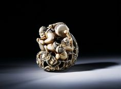 Netsuke  ~  First half of 19th century ~ Maker: Shogetsu   Carved and stained ivory