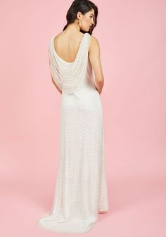 Enchant everyone with your sparkling entrance in this ivory gown! Decorated deco-style with strands of tiny pearled beads on its sheer overlay, draped with a dramatic back cowl, and finished with a faintly high-low hemline this ModCloth-exclusive stunner offers you moment after moment of maximum magnificence.