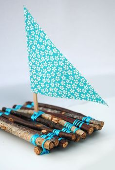 "Handmade boat made from twigs, string, a lollipop stick & some paper - will it float or sink? ("",)"