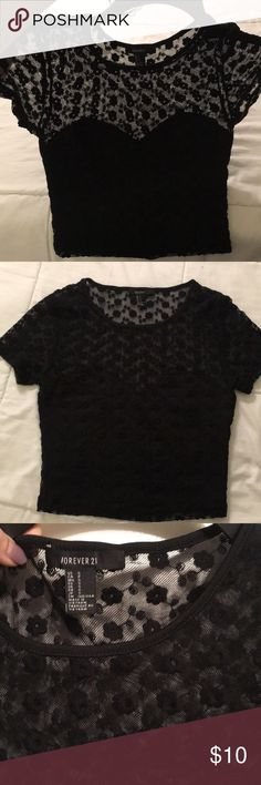 Black crop top Really cute crop top with flower patterns. See through only from the top half of the shirt wit flower designs. Forever 21 Tops Crop Tops