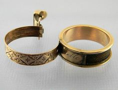 victorian mourning ring with a hinged outer layer that unlocks to reveal braided hairwork
