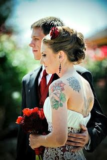 A white red wedding dress and she's got tattoos... this is what I would like