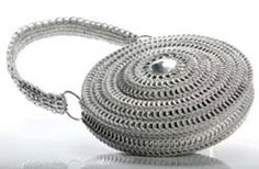 Image of Awesome Circular Pop Can Tab Purse - no tutorial, and link to maker/seller is dead, unfortunately.